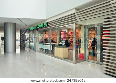 SHANGHAI-DEC. 7, 2014. Starbucks outlet. Its sales shows a healthy growth and it's planning to open 500 new locations in China, which would make China Starbucks its second largest market outside U.S. - stock photo