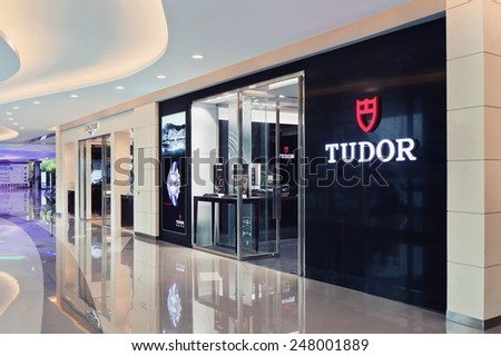 SHANGHAI-DEC. 8, 2015. Tudor outlet. Rolex and its 4subsidiary Tudor manufacture wristwatches. Founded by Hans Wilsdorf and Alfred Davis in London in 1905, Rolex moved its base to Geneva in 1919. - stock photo