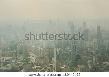"SHANGHAI - DEC 5: view of heavily polluted city center on December 5, 2013 in Shanghai, China. Air quality index levels were classed as ""Beyond Index"" (PM 2.5 of over 500 micrograms per cubic meter).  - stock photo"