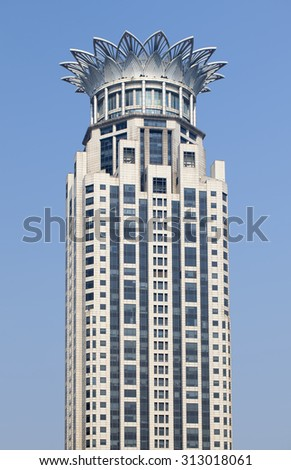 SHANGHAI-DEC. 6, 2014. Westin Bund Center Shanghai. The characteristic five star hotel is located in the center, two blocks from the famous, touristy Bund Boulevard, it has 26 floors and 570 rooms.  - stock photo