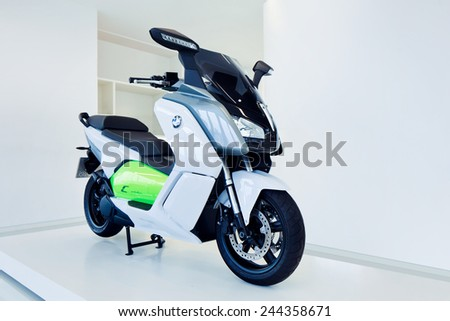 SHANGHAI-DECEMBER 9, 2014. BMW C Evolution e-scooter near-production prototype. It has a powerful motor, output of 11 kW and peak output of 35 kW, maximum speed of 75 mph and impressive acceleration. - stock photo