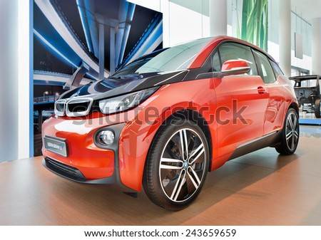 SHANGHAI-DECEMBER 9, 2014. The New BMW i3 in a showroom. It is a five-door urban electric car developed by BMW, and their first zero emissions mass-produced vehicle due to its electric power train.  - stock photo