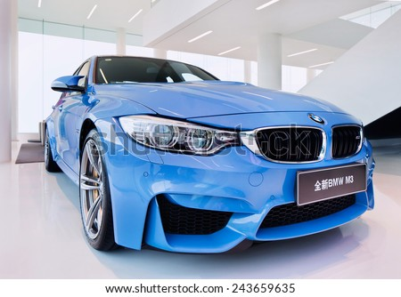 SHANGHAI-DECEMBER 9, 2014. The New BMW M3 sedan. The new BMW (425 hp) M3 sedan has a new twin-turbocharged 3.0-liter inline-six, more powerful than the atmospheric 4.0-liter V8 of its predecessor.  - stock photo