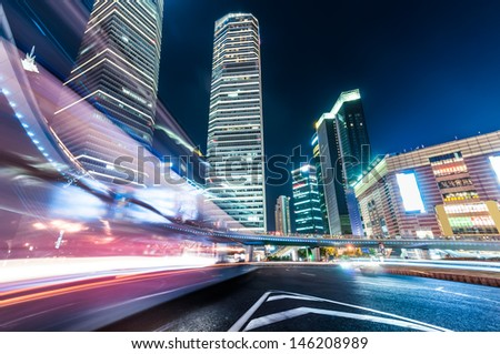 shanghai downtown at night with roundabout light trails
