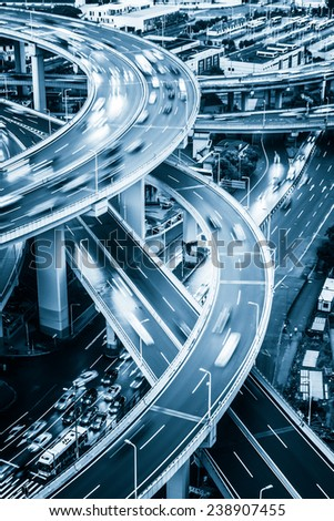 shanghai elevated road junction and interchange overpass at night - stock photo