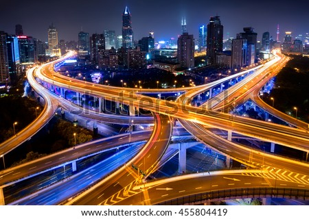 Shanghai elevated road junction and interchange overpass at night, Shanghai China - stock photo