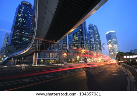Shanghai  highway viaduct traffic at of car night with light trails - stock photo