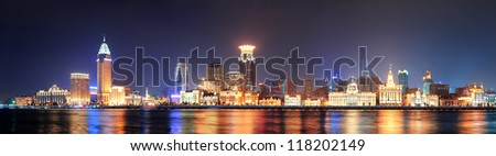 Shanghai historic architecture panorama at night lit by lights over Huangpu River - stock photo