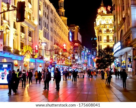 SHANGHAI JANUARY 21: Tourists at the famous shopping street, Nanjing road,  in Shanghai, China on Jan 21, 2014. Nanjing Road is one of the world's busiest shopping streets. - stock photo