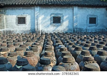 Shanghai, Jugs of distilled rice liquor at Sanbai Wine Workshop in Wuzhen historic scenic town. - stock photo