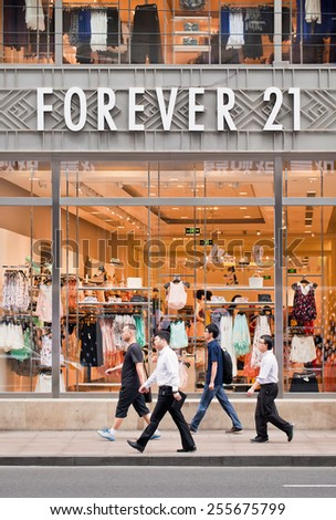 SHANGHAI-JULY 5, 2014. Forever 21 outlet. The US chain Forever 21 is known for trendy offerings and economical pricing. They sell beauty products, clothing and accessories for women, men, and girls. - stock photo