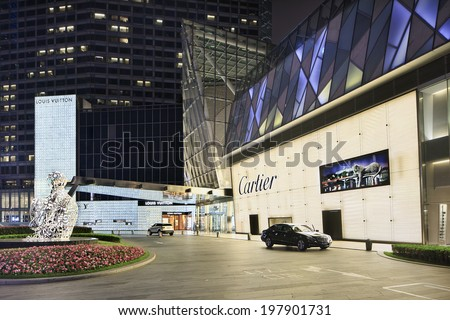 SHANGHAI�JUNE 4, 2014. Louis Vuitton and Cartier outlet. While most of the world cut down spending, Chinese consumers bought 47% of world�s luxury goods in 2013 according Fortune Character Institute. - stock photo