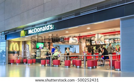 SHANGHAI-JUNE 11, 2013. MacDonalds outlet at Hongqiao Airport. The company has received more than six bids for its over 2,000 restaurants in mainland China and Hong Kong worth about $3 billion.