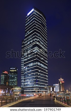 SHANGHAI-JUNE 4, 2014. Skyscraper at night on Lujiazui. It is a peninsula developed specifically as a new financial district of Shanghai. It is located on the east side of the Huangpu River in Pudong. - stock photo