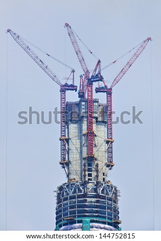 SHANGHAI-JUNE 6. Top Shanghai Tower (under construction). Tallest skyscraper China, design by Gensler, completion 2014. Specs: 632m tall, 121 stories, floor area 380,000 sq.m. Shanghai, June 6, 2013. - stock photo