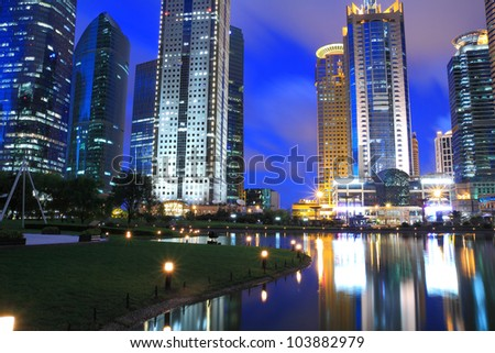 Shanghai Lujiazui Finance & City Buildings night landscape reflected in the pond - stock photo