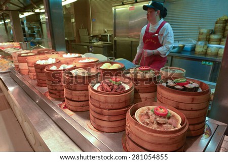 SHANGHAI - MAR 15 2015:Chinese food on display in a food market in Shanghai China.Chinese cuisine go back for thousands of years, changed according to climate, imperial fashions and local preferences. - stock photo