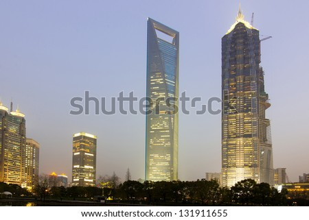 SHANGHAI - March 4: Jin Mao Tower and Shanghai word financial center (who is the TOP 3 high in this word and TOP 1 high in China, total high 493 meters) and on March 4, 2013 in Shanghai, china. - stock photo