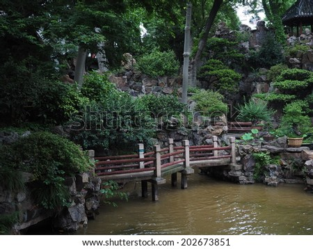 SHANGHAI - MAY 18 : Tourists visit Yuyuan garden during Chinese National Day holiday on May 18, 2014 in Shanghai, China. During this holiday around 740 million trips will be made by Chinese people. - stock photo