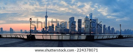 Shanghai morning panorama before sunrise with city skyline and colorful sky over Huangpu River - stock photo