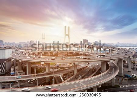 shanghai nanpu bridge at dusk , busy city traffic closeup  - stock photo