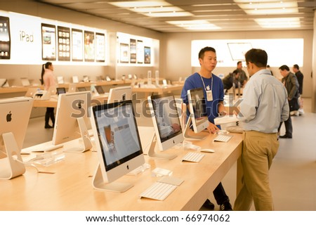 SHANGHAI - NOV 30: Apple store interior in Shanghai on Nov 30, 2010 in Shanghai. China's second Apple store opened on July 10, 2010 in the high profile Pudong district. - stock photo