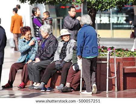 SHANGHAI - NOV 4, 2012: Old Chinese people in East Nanjing Road, Shanghai, China. China is facing the aging population problem due to its 36 years one child policy.