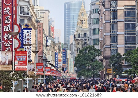 SHANGHAI-NOV. 20, 2010. Shopping at Nanjing Road on Nov. 20, 2010 in Shanghai. Shanghai 2010 retail sales reached RMB 603.7 billion, ranked second to Beijing among China's top 10 commercial cities. - stock photo