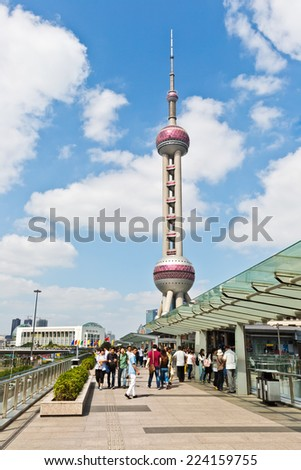 Shanghai - October 1: visitors before the Oriental pearl TV tower,  On October 1, 2014 in Shanghai, China. the Oriental pearl TV tower is a famous landmark in Shanghai. - stock photo