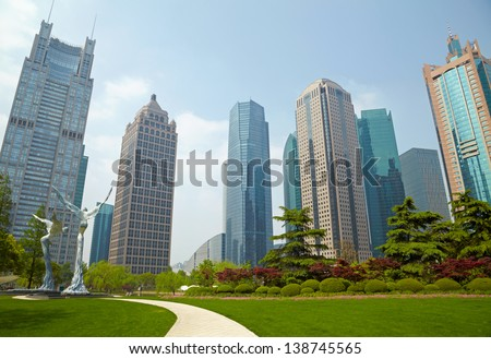 Shanghai park and  skyscrapers - stock photo