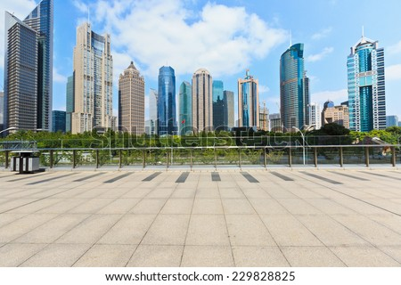 Shanghai pedestrian bridge in front of the skyscrapers - stock photo