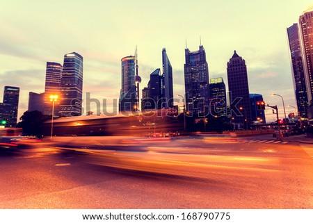 Shanghai Pudong car light trails - stock photo