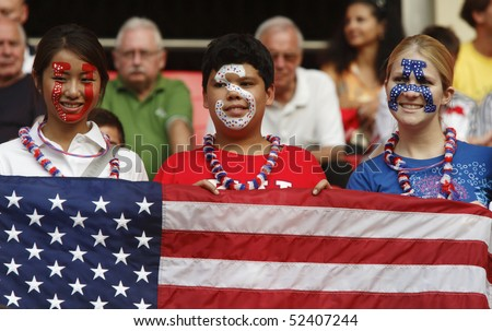SHANGHAI - SEPTEMBER 30:  USA fans in the stands prior to the Women's World Cup third place match between Norway and the USA September 30, 2007 in Shanghai, China. - stock photo