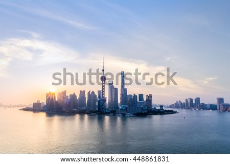 shanghai skyline and huangpu river in sunup , charming metropolitan background