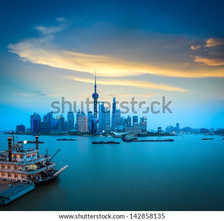 shanghai skyline and huangpu river scenery in sunset - stock photo