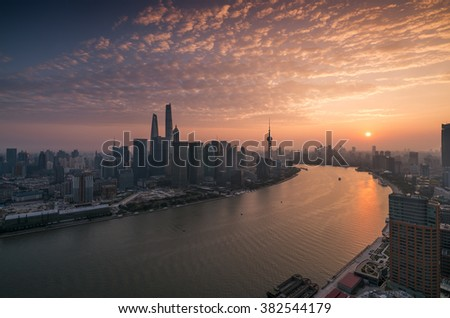 shanghai skyline and huangpu river with sunset glow  - stock photo
