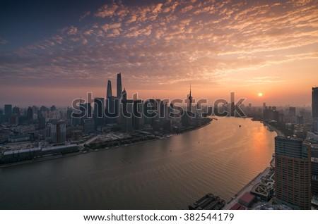 shanghai skyline and huangpu river with sunset glow  - stock photo