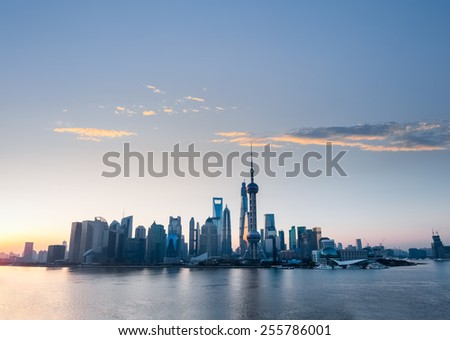 shanghai skyline in sunrise with rosy clouds of dawn - stock photo