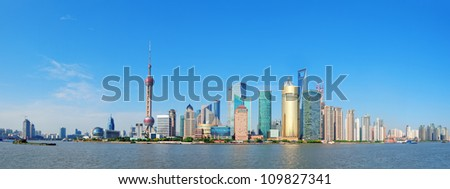 Shanghai skyline panorama with skyscrapers and blue clear sky over Huangpu River. - stock photo