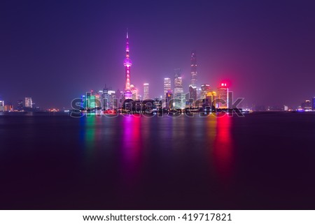 Shanghai skyline view from Bund waterfront on Pudong New Area- the business quarter of the Shanghai.  - stock photo