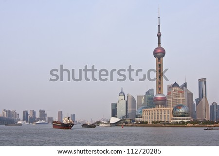Shanghai - the largest city by population in China, and in the world. Pu dong district, by the side of Huang pu River. Oriental Pearl Tower. Shanghai Modern Architectural Design. Morning.