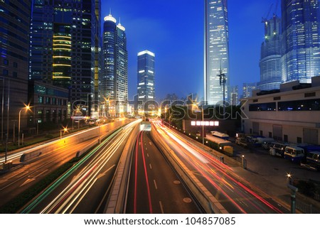 Shanghai Urban transport traffic rainbow  light trails - stock photo