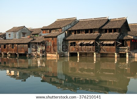 Shanghai, Wuzhen historic scenic town typical old houses reflection in a canal - stock photo