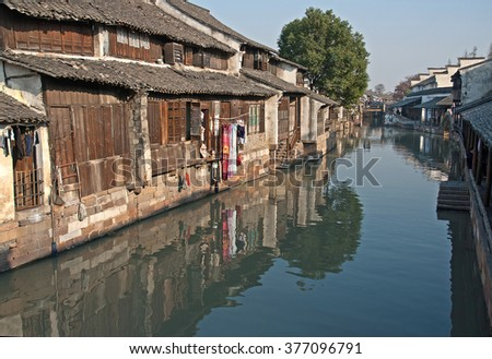 Shanghai, Wuzhen historic scenic town typical old houses reflection in a canal.   - stock photo