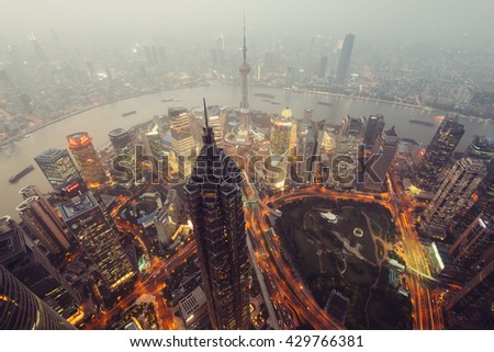 Shanghail, China - Oct 13, 2015: Elevated view of Lujiazui district in Shanghai, in Mao Tower in the foreground. Lujiazui has been developed specifically as a new financial district of Shanghai.  - stock photo