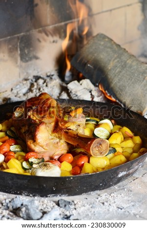 Shank with potatoes in the oven - stock photo