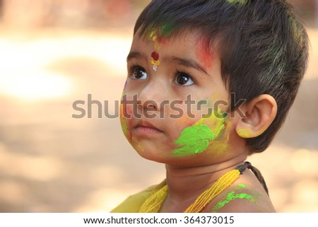 Shantiniketan, West Bengal, India- 5th March, unindentified child during Holi festival of colors, March 5, 2015 in India. Holi marks the arrival of spring, being one of the biggest festival in Asia. - stock photo