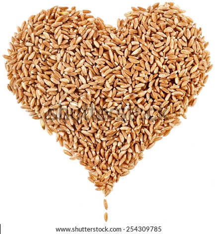 Shape Heart of Spelt Grains Close up top view surface isolated on pure white background - stock photo