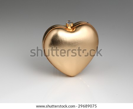 Shape of a heart handle evening bag.