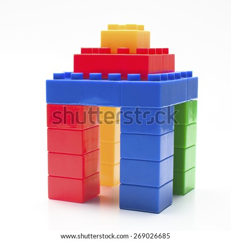 Shape of house made from plastic building blocks. - stock photo